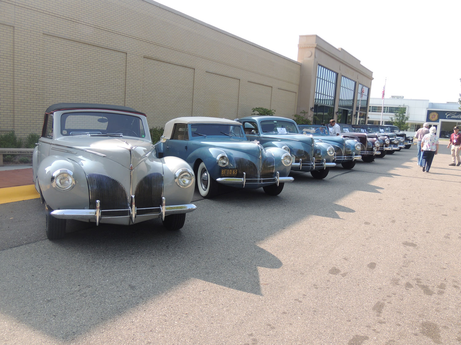 A row of Lincoln-Zephyrs in front of the Lincoln Motor Car Heritage Museum.